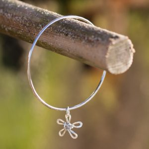 2mm bangle with a wire daisy charm attached